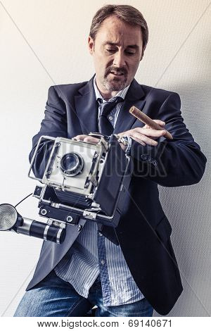 Photographer With Old Camera Looking At His Watch