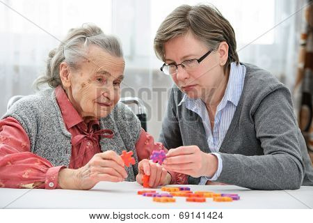 Senior Woman With Her Elder Care Nurse