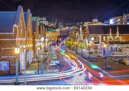 HAKODATE, JAPAN - OCTOBER 24, 2012: Traffic passes the warehouse district. The city opened in 1859 as one of the first international ports of Japan and the warehouses remain from that time.