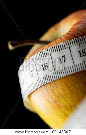 Nutritious Apple, Wrapped With A Measuring Tape