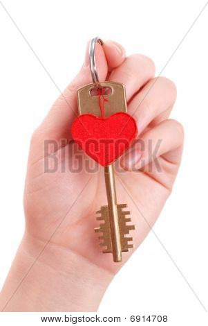 The Woman Hand Holds A Key To Heart