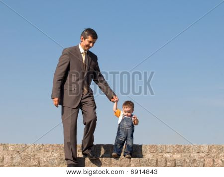 Father And His Little Son Outdoors