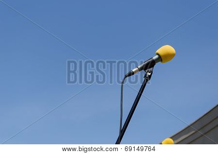 Yellow Microphone On Blue Sky Background