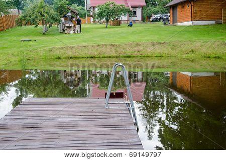 Rural Pond With Large Plank Bridge Village Yard