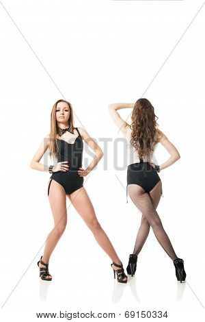 Go-go dancing women posing against white