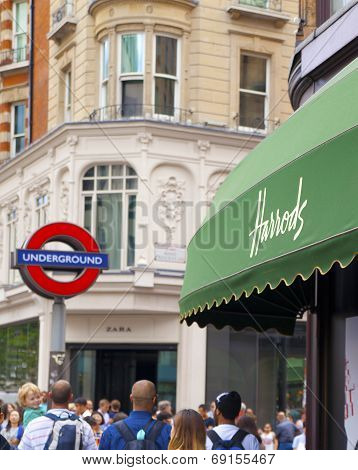 LONDON, UK - JUNE 3, 2014: Harrods department store, shopping and restaurants tourists point. Harrod
