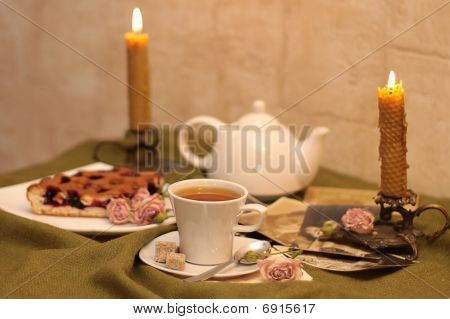 Cup Of Tea And Cane Sugar Against A Background
