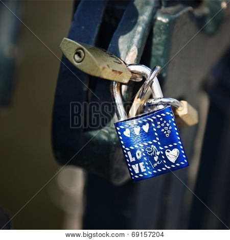 Padlock attached to a railing as a token of love