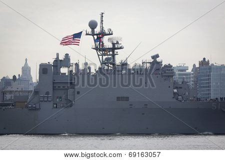 NEW YORK - MAY 27: The American flag flies from the USS Oak Hill (LDS 051) as it heads down the Hudson River at the end of Fleet Week NY on May 27, 2014.
