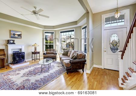 House Interior With Open Floor Plan. Living Room And Entrance Hall