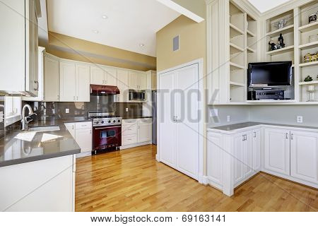 White Kitchen Room With Burgundy Stove