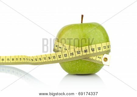 Studio Shot Of Whole Green Healthy Apple With Tape Measure