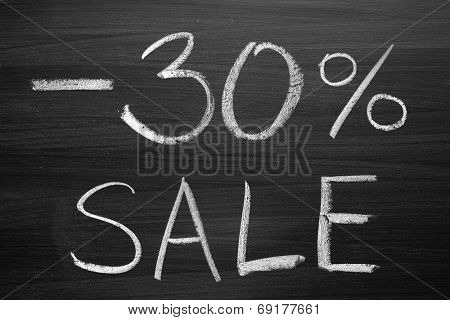 30-percent sale title written with a chalk on the blackboard