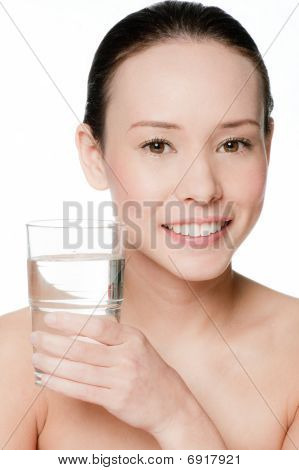 Young And Attractive Woman With A Glass Of Water