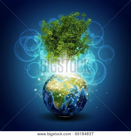 Earth with magical green tree and rays of light