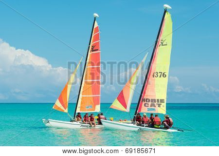 CAYO SANTA MARIA, CUBA - JULY 15, 2014 : Tourists sailing in colorful catamarans on a beautiful sunny day at the key