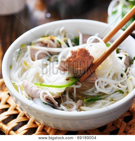 eating a steamy bowl of pho