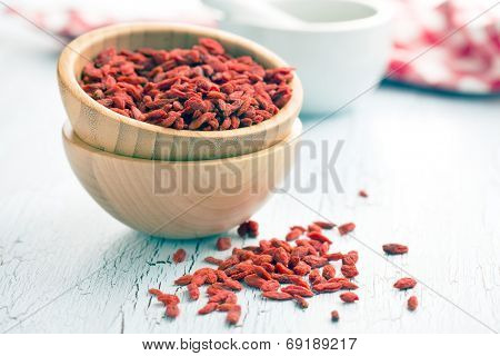 dried goji berries on old table