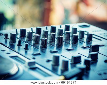 Closeup of dj controller with selective focus