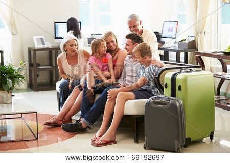 Multi Generation Family Arriving In Hotel Lobby