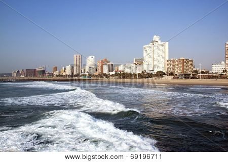 Empty Ocean And Beach Against City Skyline