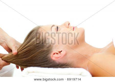 Relaxed Woman Enjoying A Hair Massage