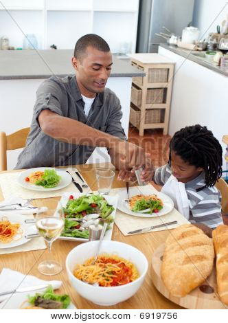 Ethnic Little Boy Dining With His Father