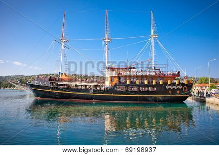 HAKIDIKI, GREECE-MAY 25, 2014: Pirate ship for tourists in Ormos Panagias, Greece on May 25, 2014. The pirate ship transport tourists around holy Athos peninsula, Halkidiki,  Greece.