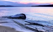 stock photo of shipwreck  - Shipwreck along a remote Lake Superior beach in Pictured Rocks National Lakeshore in Michigan - JPG