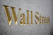 picture of nyse  - Wall Street golden sign curved in stone  - JPG
