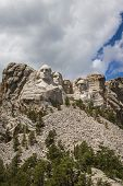 foto of mount rushmore national memorial  - view of Mount Rushmore National Monument on a spring morning with some clouds and sunshine - JPG