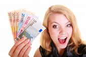 pic of economy  - Rich happy blonde business woman showing euro currency money banknotes - JPG