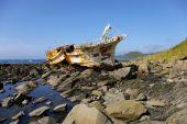 stock photo of sakhalin  - Broken fishing schooner on stone  - JPG
