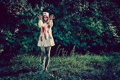 image of walking dead  - Woman zombie walking dead outdoors - JPG