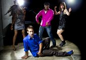 stock photo of peer-pressure  - Caucasian man falls but confidently plays cool in a dance club - JPG