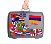 stock photo of armenia  - Used plastic suitcase with lots of small stickers large sticker of Armenia - JPG