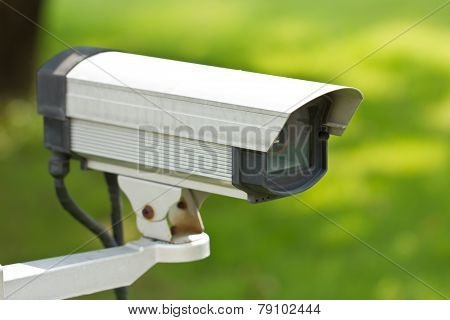 Close Up Of Security Surveillance Camera Isolated On Green Background.