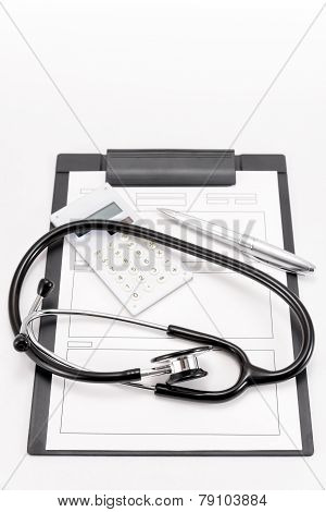 Stethoscope And Medical Records And Calculator.