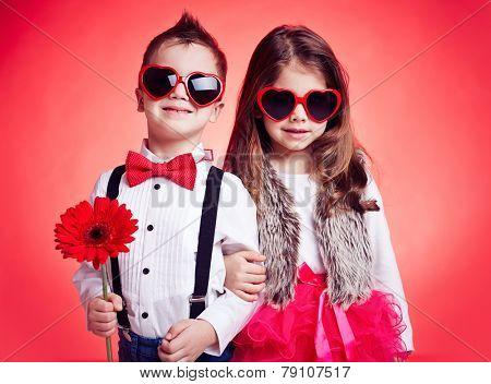 Portrait of well-dressed children in sunglasses