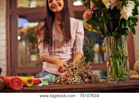 Woman making bouquet of different flowers