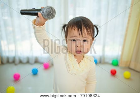 Little Asian Girl With Microphone