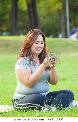 Happy Fatty Woman Using Mobile Phone