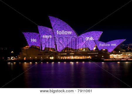 Sydney Opera House under festival lights.