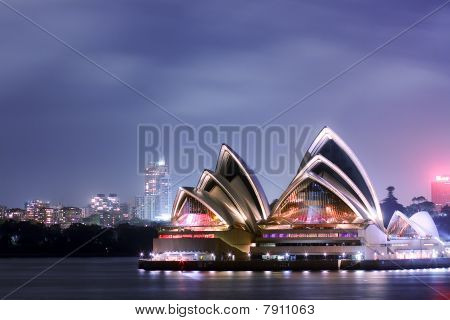 Sydney Opera House under festival lights.