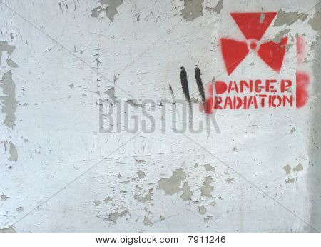 White Peeling Paint On Wall With Radiation Warning