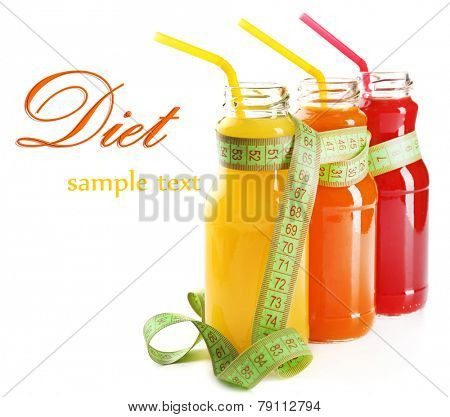 Bottles of diet drinks with measuring tape isolated on white, Diet concept
