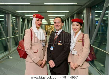 MOSCOW -JUNE 04: Emirates crew members after landing on June 04, 2014 in Moscow, Russia. Emirates handles major part of passenger traffic and aircraft movements at the airport.