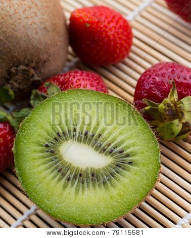 Kiwi And Strawberries Shows Berry Tropical And Ripe