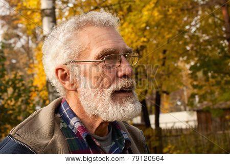 elderly man in autumn forest