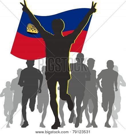Athlete with the Liechtenstein flag at the finish